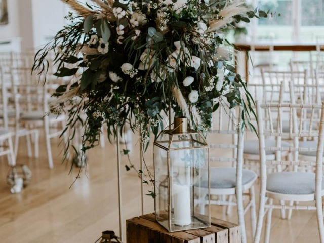 Luxury wow factor table centrepiece, unstructured, foliage, messy, green and white, ceremony flowers, aisle decor, candle light, lanterns, wedding flowers, dorset, hampshire, wiltshire