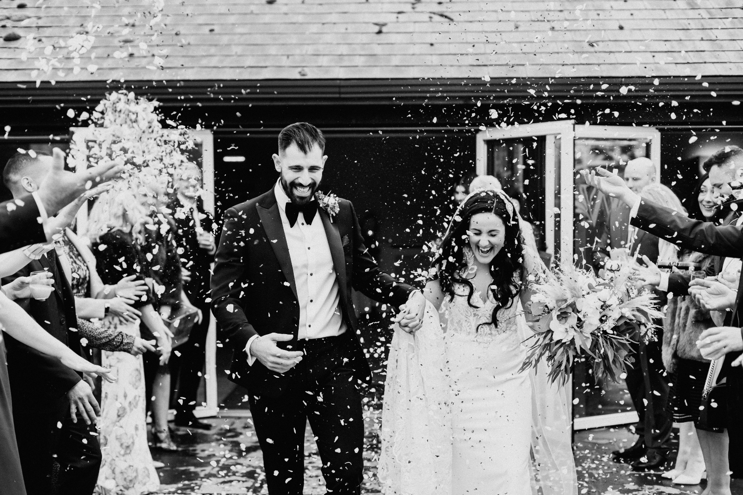 black and white wedding flower, bride and groom, confetti shot