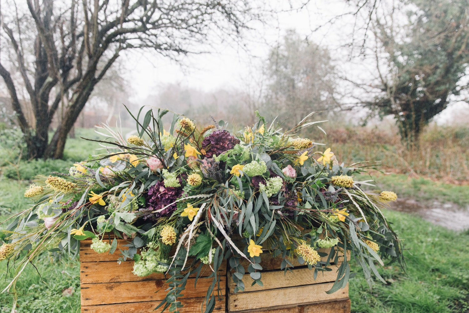 large rustic luxury coffin spray, funeral flowers, sympathy flowers, lilac, lemon, green, yellow