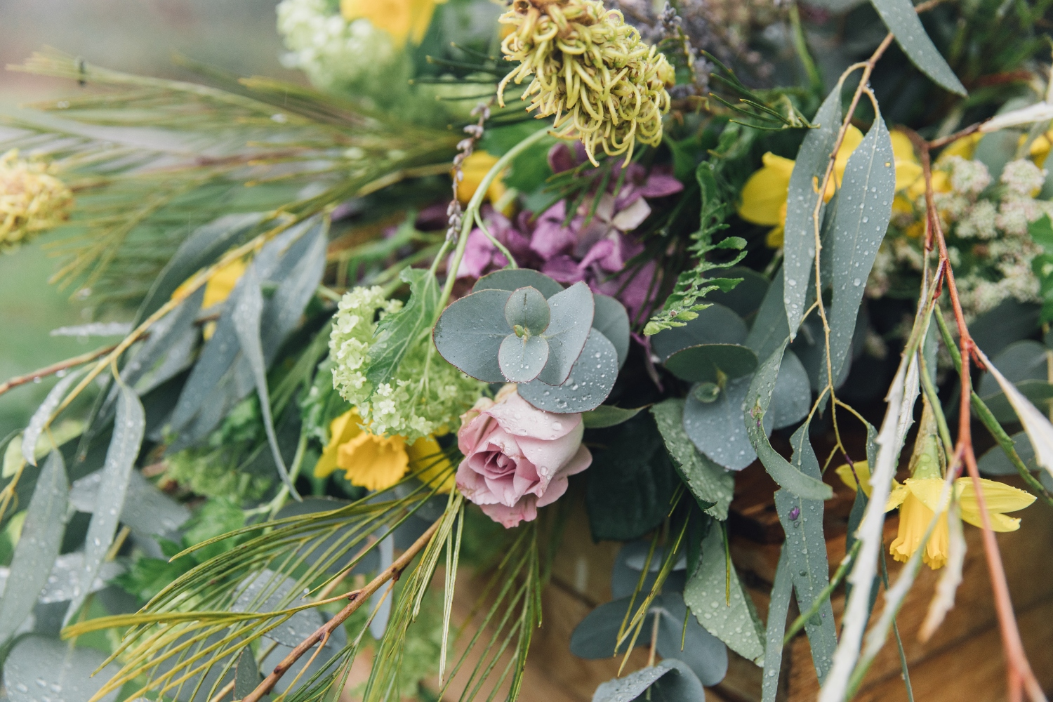 spring flower rustic coffin spray, funeral flowers, sympathy flowers, lilac rose, lemon daffodil, eucalyptus