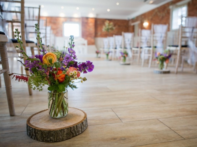 ceremony flowers, log slice, floral jam jar, wedding flowers, sopley mill dorset