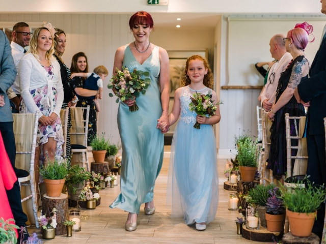 Garden inspired aisle decor at sopley mill, dorset, wedding flowers, bridesmaids flowers, plants, rustic, woodland