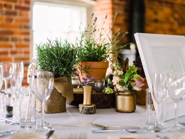Eclectic table styling, table centrepiece, rustic wedding flowers, plants, succulents, lavender, herbs, candles, floral jars, gold, sopley mill, wedding flowers, dorset, hampshire
