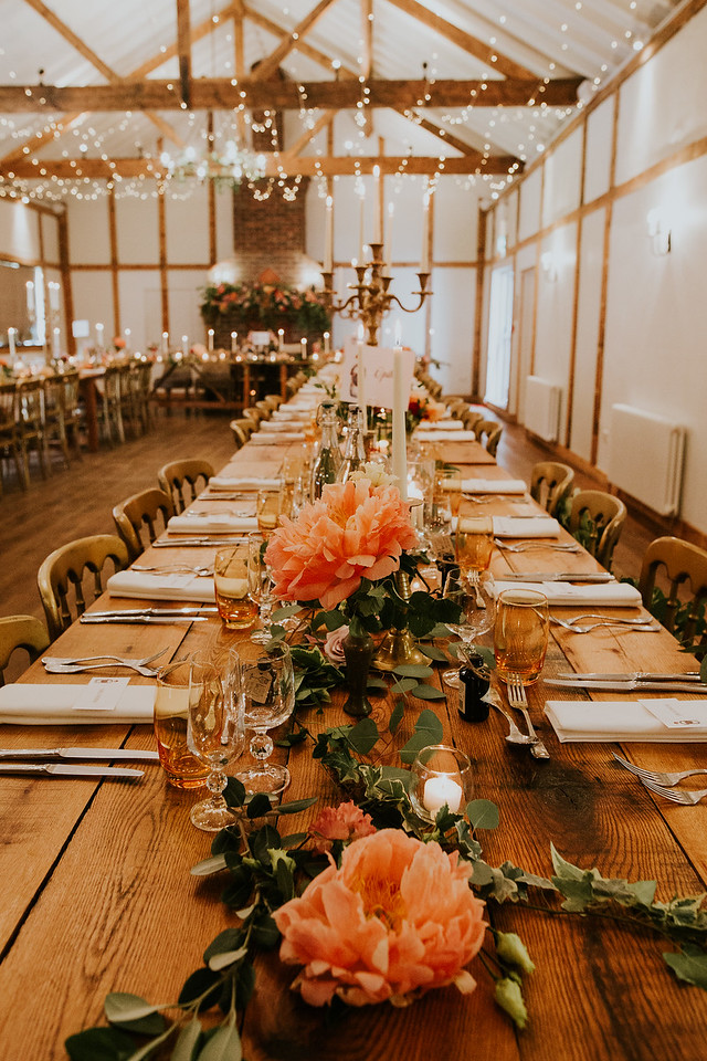 long trestle table, tablescape, table centrepiece, burley manor wedding, wedding flowers, peony, peach, table styling, candlesticks, fireplace flowers, barn wedding, dorset, hampshire