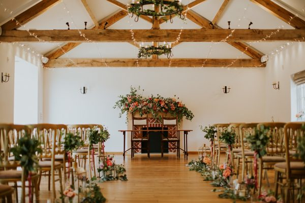 Ceremony flowers Burley Manor, aisle flowers, chair flowers, candle light styling, fireplace flowers, spring flowers, autumn, ceremony, new forest dorset hampshire, wedding florist