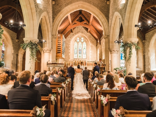 Church wedding, church flowers, foliage garland, foliage columns, floral jars, aisle flowers, wedding ceremony, ceremony styling, Hampshire