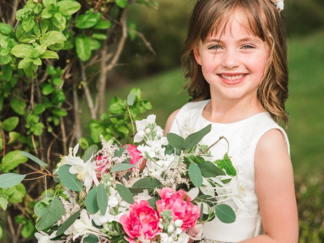 Super cute flower girl holding the brides bouquet, Cain Manor, Hampshire