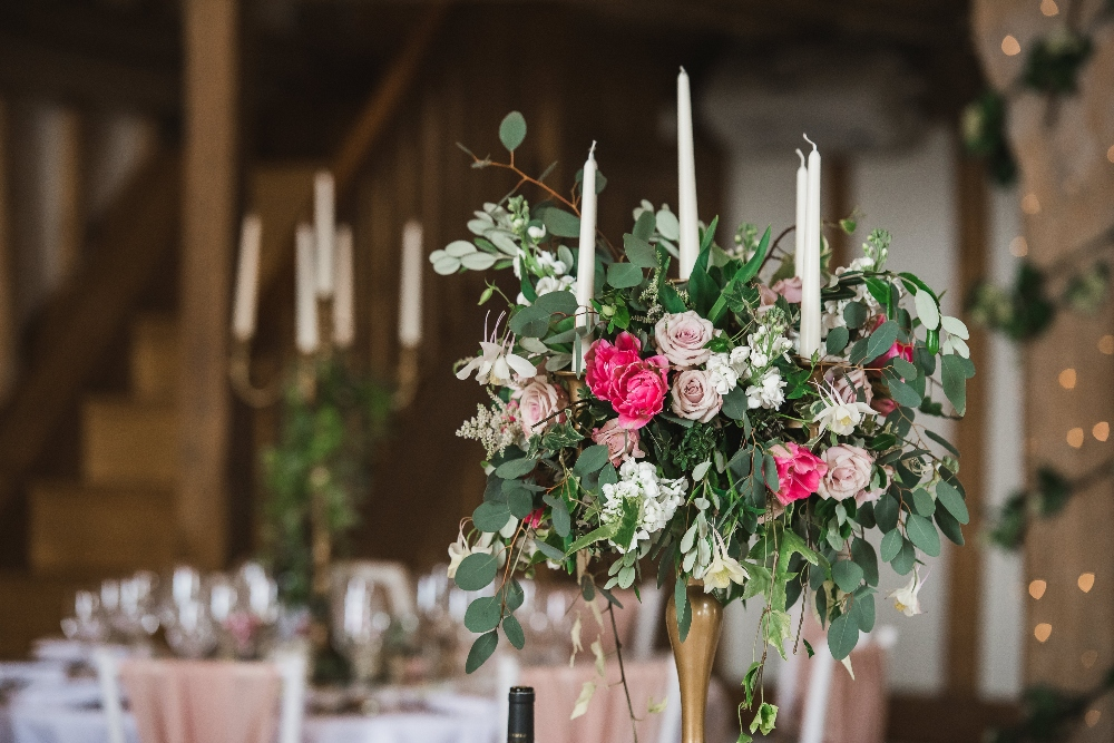 wild garden flower table centrepiece, cain manor, hampshire, gold candlesticks, candelabra