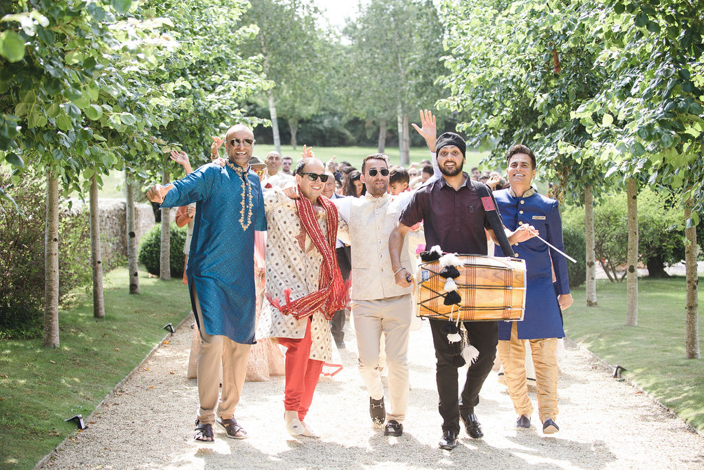 Traditional Indian wedding march axnoller weddings, dorset