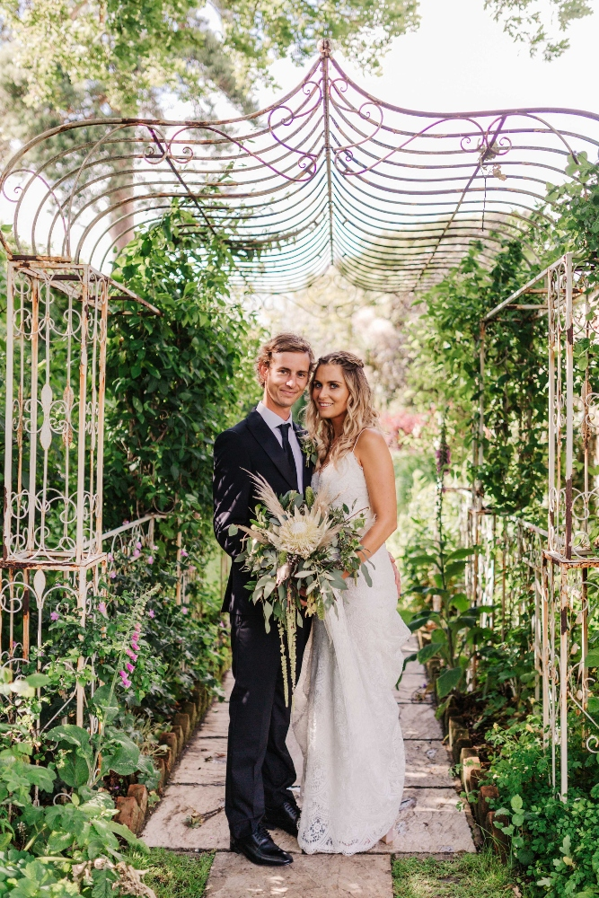 Garden wedding, parley manor, bride and groom, lace, bridal bouquet, protea, pampas grass, dorset wedding florist