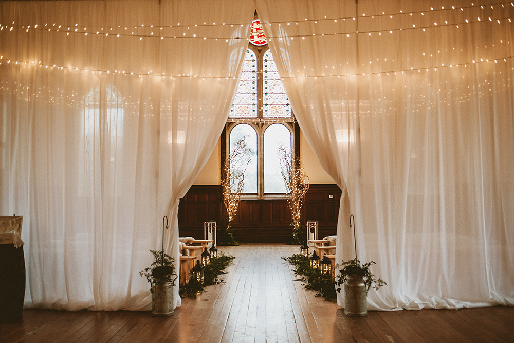 Fairy lights, fairy light arch, wedding ceremony, bride and groom, winter wedding, willow tree's, wedding flowers, wedding florist, dorset, hampshire
