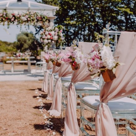 floral jam jar aisle flowers chair flowers outdoor ceremony penn castle dorset hampshire wedding flowers florist pink white peony rose floral arch pagoda