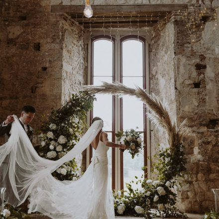 LULWORTH CASTLE CEREMONY FLOWERS MOONGATE ARCH PAMPAS GRASS GREEN AND WHITE GARDEN FLOWERS ROSE PEONY