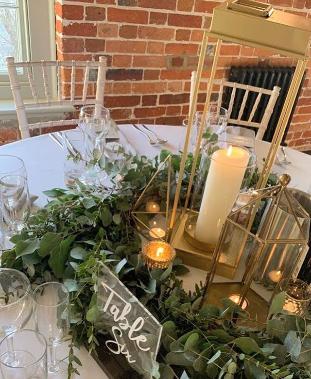candle light table centrepiece gold lantern tea light foliage eucalyptus garland sopley mill wedding florist flowers dorset